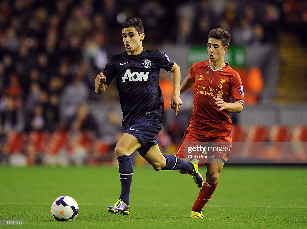 Andreas Pereira of Manchester United runs away from Cameron Brannagan of Liverpool during the Barclays U21 Premier League Semi Final match between Liverpool and Manchester United at Anfield on May 02, 2014 in Liverpool, England.