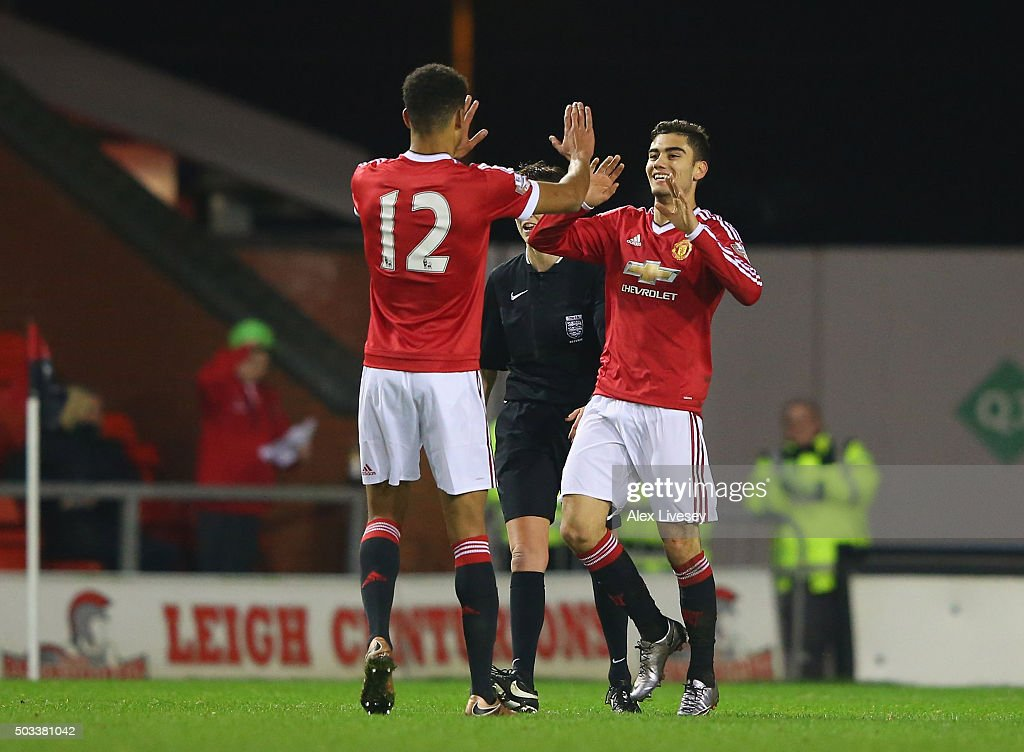 Andreas Pereira of Manchester United U21 celebrates with Ashley Fletcher after scoring their third goal during the Barclays U21 Premier League match between Manchester United U21 and Tottenham Hotspur U21 at Leigh Sports Village on January 4, 2016 in Leigh, Greater Manchester.