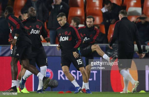 Andreas Pereira of Manchester United warms up ahead of the UEFA Champions League Group H match between Valencia and Manchester United at Estadio...