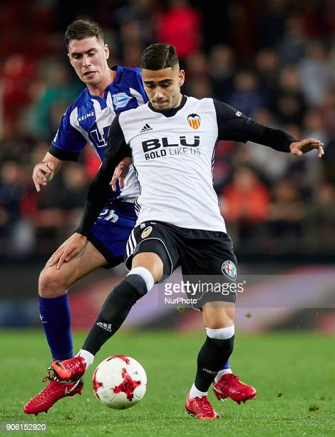 Andreas Pereira of Valencia CF competes for the ball with Dieguez of Deportivo Alaves during the Copa del Rey quarterfinal first leg game between...