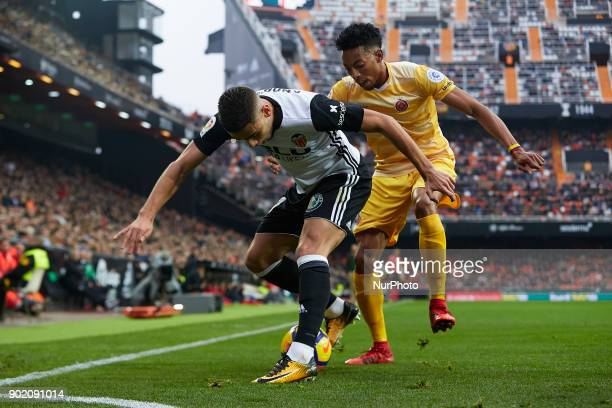 Andreas Pereira of Valencia CF competes for the ball with Johan Mojica of Girona FC during the La Liga game between Valencia CF and Girona FC at...
