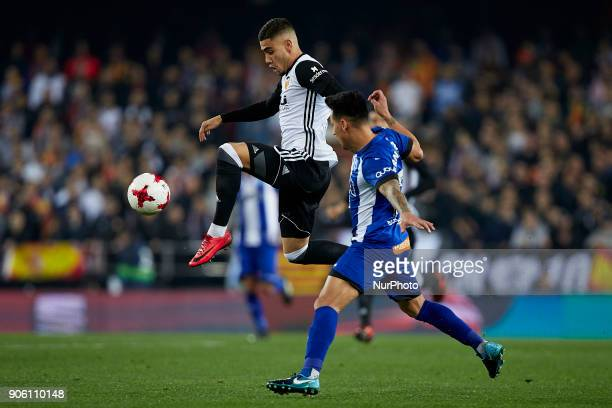 Andreas Pereira of Valencia CF controls the ball next to Hernan Perez of Deportivo Alaves during the Copa del Rey quarterfinal first leg game between...
