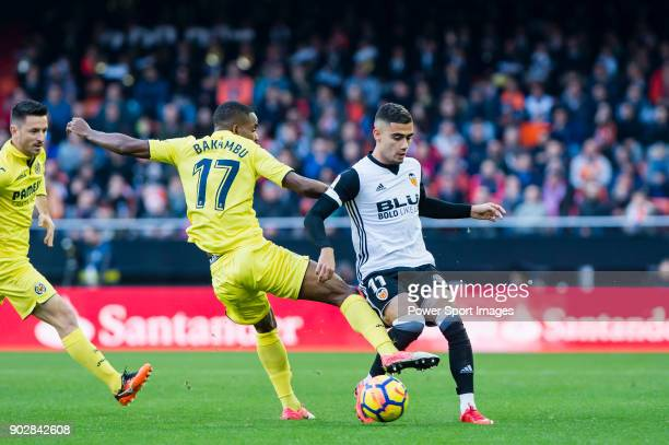Andreas Pereira of Valencia CF fights for the ball with Cedric Bakambu of Villarreal CF during the La Liga 201718 match between Valencia CF and...