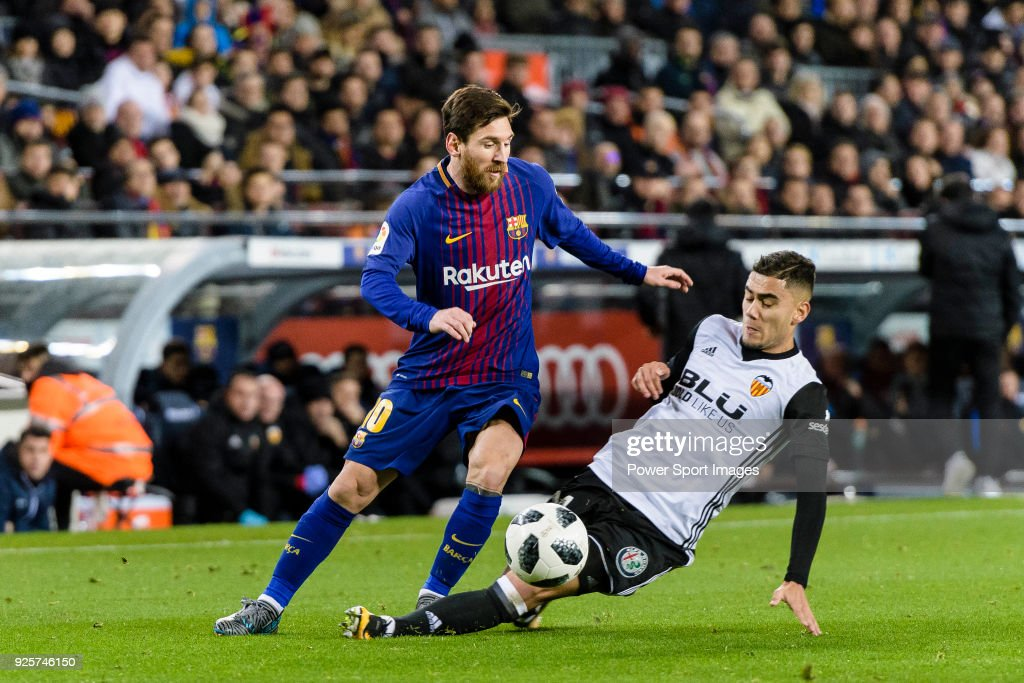 Andreas Pereira of Valencia CF (R) trips up with Lionel Messi of FC Barcelona (L) during the Copa Del Rey 2017-18 match between FC Barcelona and Valencia CF at Camp Nou Stadium on 01 February 2018 in Barcelona, Spain. Photo by Power Sport Images/Getty Images