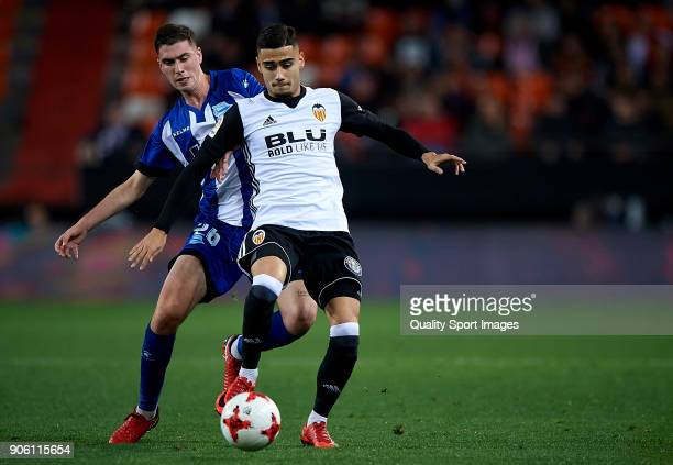 Andreas Pereira of Valencia competes for the ball with Adrian Dieguez of Alaves during the Copa Del Rey 1st leg match between Valencia and Alaves at...
