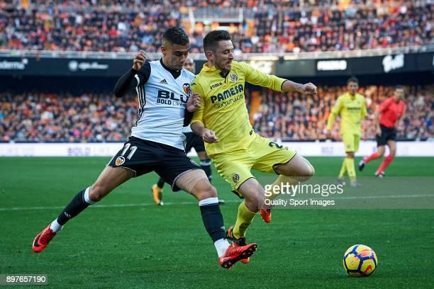 Andreas Pereira of Valencia competes for the ball with Antonio Rukavina of Villarreal during the La Liga match between Valencia and Villarreal at...