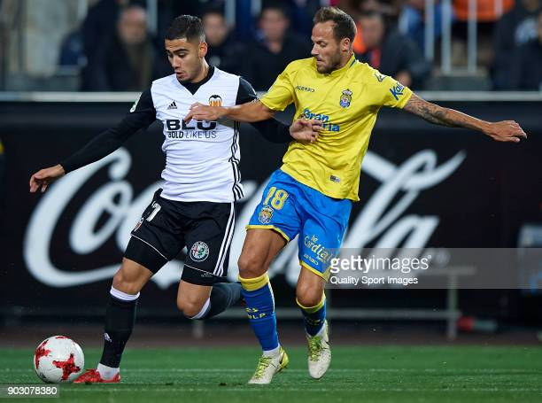 Andreas Pereira of Valencia competes for the ball with Javi Castellano of Las Palmas during the Copa Del Rey 2nd leg match between Valencia and Las...