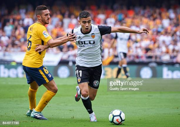 Andreas Pereira of Valencia competes fot the ball with Koke of Atletico Madrid during the La Liga match between Valencia and Atletico Madrid at on...