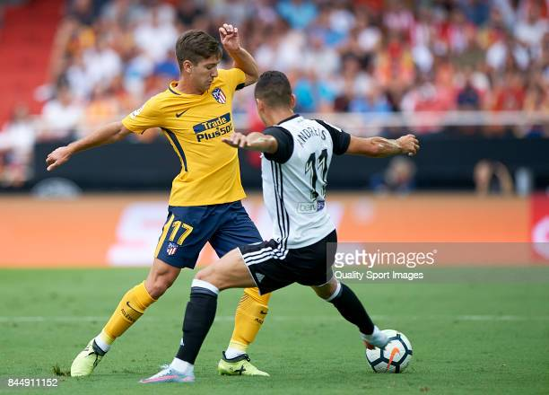 Andreas Pereira of Valencia competes fot the ball with Luciano Vietto of Atletico Madrid during the La Liga match between Valencia and Atletico...