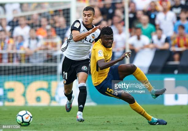 Andreas Pereira of Valencia competes fot the ball with Thomas Teye Partey of Atletico Madrid during the La Liga match between Valencia and Atletico...