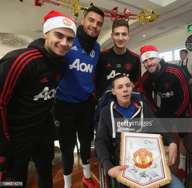 Andreas Pereira Sergio Romero Diogo Dalot and Luke Shaw of Manchester United pose with Callum during the MU Foundation's Dream Day at Aon Training...