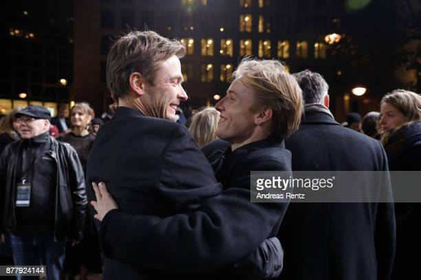Andreas Pietschmann and Louis Hofmann attend the premiere of the first German Netflix series 'Dark' at Zoo Palast on November 20 2017 in Berlin...
