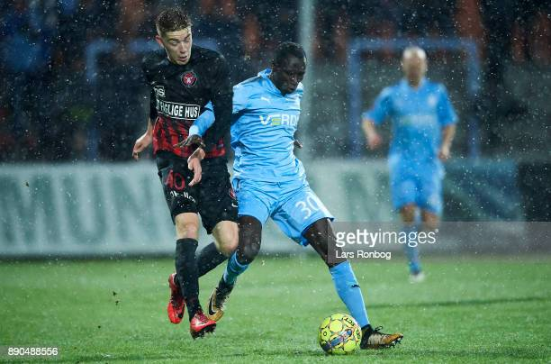 Andreas Poulsen of FC Midtjylland and Ibrahima Ndiaye Mame of Randers FC compete for the ball during the Danish Alka Superliga match between Randers...