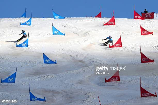 Andreas Prommegger of Austria and Benjamin Karl of Austria competes in the big final of the Men's Parallel Slalom on day eight of the FIS Freestyle...