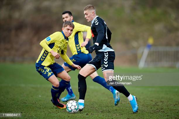 Andreas Pyndt Andersen of Brondby IF and Artem Dovbyk of SonderjyskE compete for the ball during the testmatch between Brondby IF and SonderjyskE at...