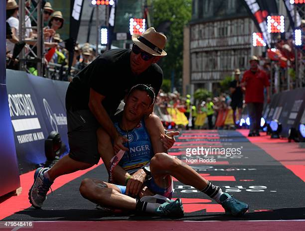 Andreas Raelert of Germany reacts after finishing the Ironman European Championships Frankfurt on July 5 2015 in Frankfurt am Main Germany