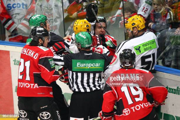 Andreas Renz of the Haie attacks Daniel Kunce of Frankfurt Lions during the DEL match between Koelner Haie and Frankfurt Lions at the Lanxess Arena...