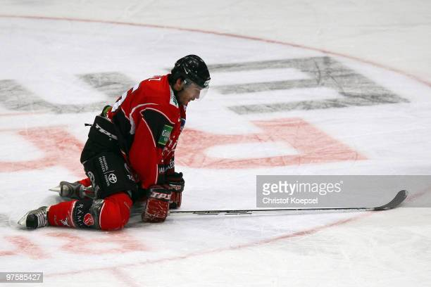 Andreas Renz of the Koelner Haie knees down on the ice during the DEL match between Koelner Haie and ERC Ingolstadt at the Lanxess Arena on March 9...