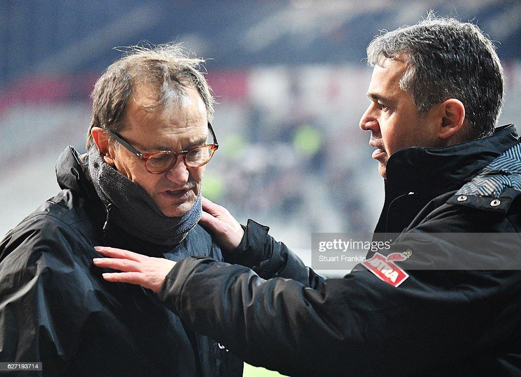Andreas Rettig Club President of St Pauli chats to Ewald Lienen head coach of St Pauli after the Second Bundesliga match between FC St. Pauli and 1. FC Kaiserslautern at Millerntor Stadium on December 2, 2016 in Hamburg, Germany.