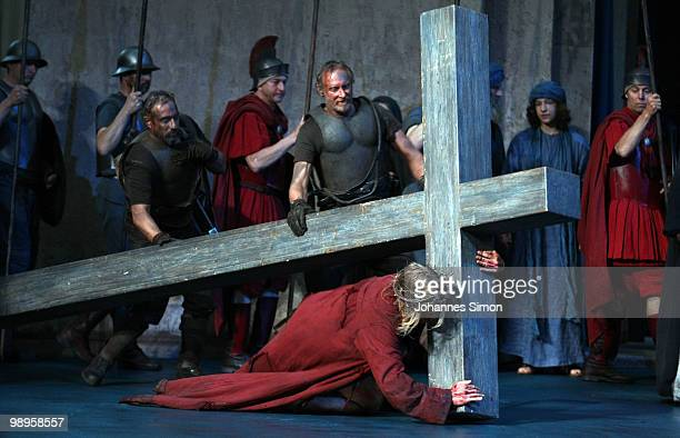 Andreas Richter as Jesus Christ and ensemble members perform on stage during the Oberammergau passionplay 2010 final dress rehearsal on May 10, 2010...