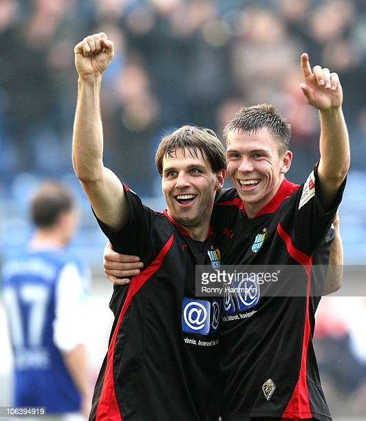 Andreas Richter of Chemnitz celebrates his teams fifth goal with team mate Marcel Wilke during the Regionalliga match between FC Magdeburg and...