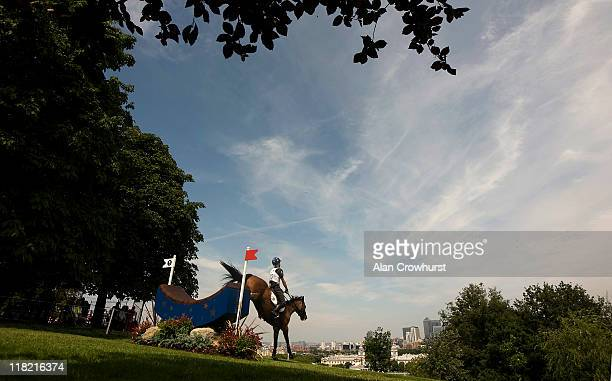 Andreas Riedl of Austria riding Jabadaba Doo clears the Crescent Moon fence during the Olympic cross country test event in Greenwich Park on July 05...