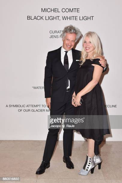 Andreas Ritter and guest attendsMichel Comte Black Light White Light Opening at Triennale di Milano on November 27 2017 in Milan Italy