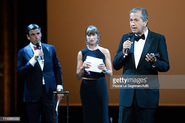 Andreas Rumbler Sandra Nedvetskaia and Mario Testino on stage during the dinner at the 'Love Ball' hosted by Natalia Vodianova in support of The...