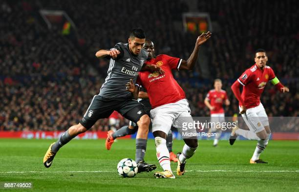 Andreas Samaris of Benfica is tackled by Eric Bailly of Manchester United during the UEFA Champions League group A match between Manchester United...