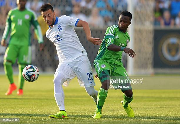 Andreas Samaris of Greece and Ogenyi Onazi of Nigeria battle for the ball during an international friendly match at PPL Park on June 3 2014 in...