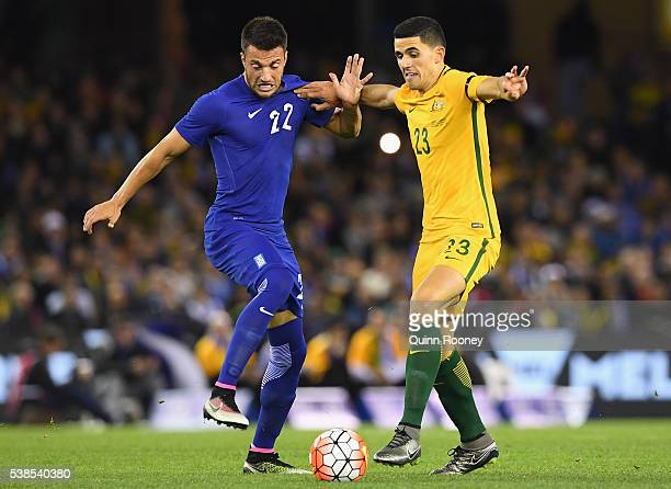 Andreas Samaris of Greece and Tomas Rogic of Australia compete for the ball during the International Friendly match between the Australian Socceroos...