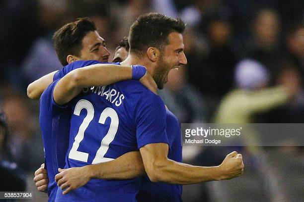 Andreas Samaris of Greece celebrates a goal from teammate Petros Mantalos during the International Friendly match between the Australian Socceroos...