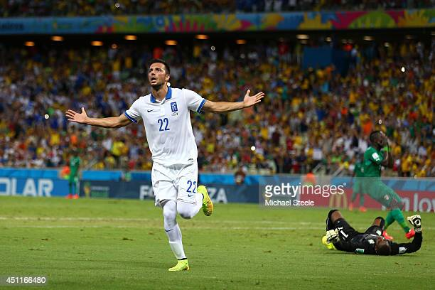 Andreas Samaris of Greece celebrates scoring his team's first goal past goalkeeper Boubacar Barry of the Ivory Coast during the 2014 FIFA World Cup...