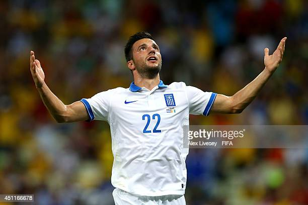 Andreas Samaris of Greece celebrates scoring his team's first goal during the 2014 FIFA World Cup Brazil Group C match between Greece and Cote...