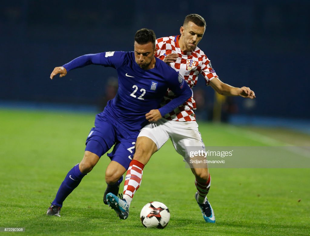 Andreas Samaris (L) of Greece is challenged by Ivan Perisic (R) of Croatia during the FIFA 2018 World Cup Qualifier Play-Off: First Leg between Croatia and Greece at Stadion Maksimir on November 9, 2017 in Zagreb, Croatia