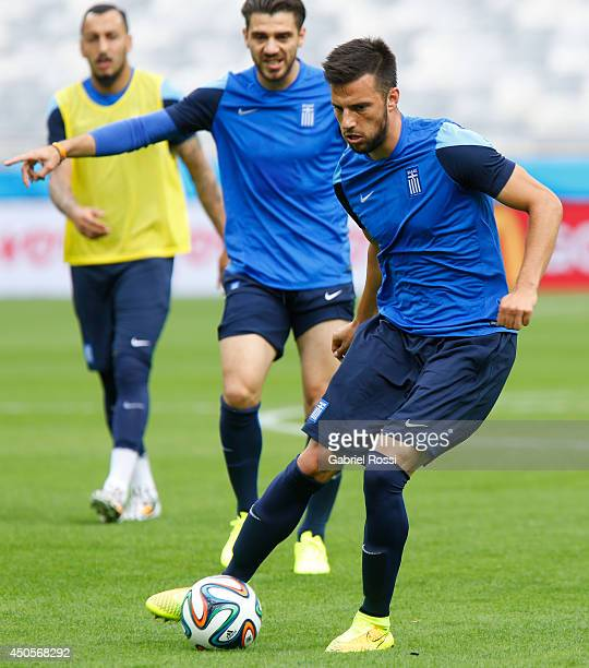 Andreas Samaris of Greece kicks the ball during the training session ahead of the Group C match between Greece and Colombia as part of FIFA World Cup...