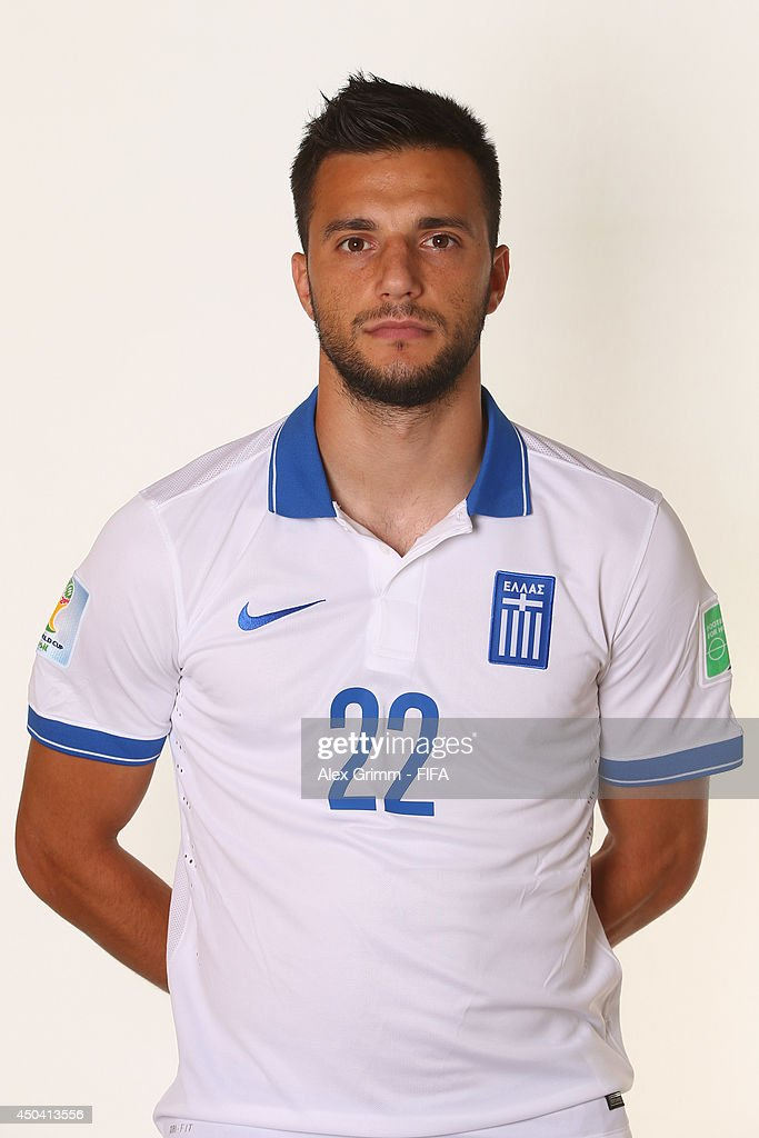 Andreas Samaris of Greece poses during the official FIFA World Cup 2014 portrait session on June 10, 2014 in Aracaju, Brazil.