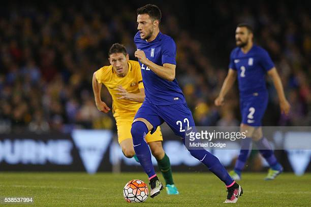 Andreas Samaris of Greece runs with the ball during the International Friendly match between the Australian Socceroos and Greece at Etihad Stadium on...