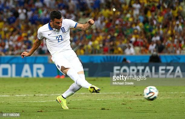 Andreas Samaris of Greece scores his team's first goal during the 2014 FIFA World Cup Brazil Group C match between Greece and the Ivory Coast at...