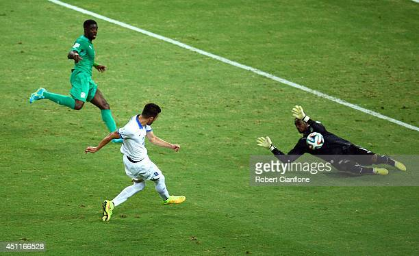 Andreas Samaris of Greece scores his team's first goal past Boubacar Barry of the Ivory Coast during the 2014 FIFA World Cup Brazil Group C match...