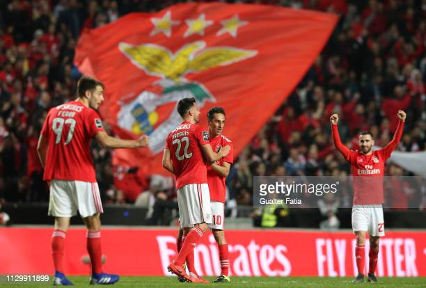 Andreas Samaris of SL Benfica celebrates with teammate Jonas of SL Benfica after scoring a goal during the Liga NOS match between SL Benfica and...
