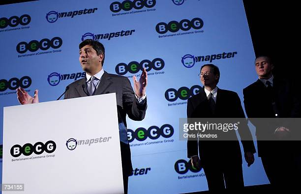 Andreas Schmidt President and CEO of Bertelsmann eCommerce Group left addresses a press conference October 31 2000 as Napster CEO Hank Barry middle...