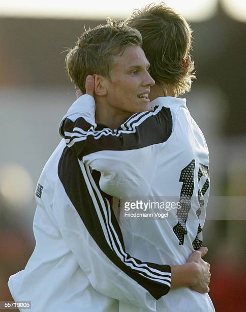 Andreas Schon celebrates scoring the fourth goal with Manuel Fischer of Germany during the men's under 17 four nation match between Germany and...