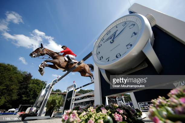 Andreas Schou of Denmark riding A-Girl competes during Day 4 of the Longines FEI Jumping European Championship 2nd part, team Jumping 1st round...