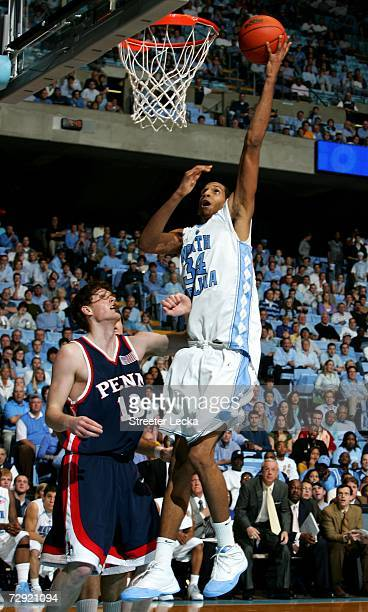 Andreas Schreiber of the Pennsylvania Quakers watches as Brandan Wright of the University of North Carolina Tar Heels goes to the basket on January 3...