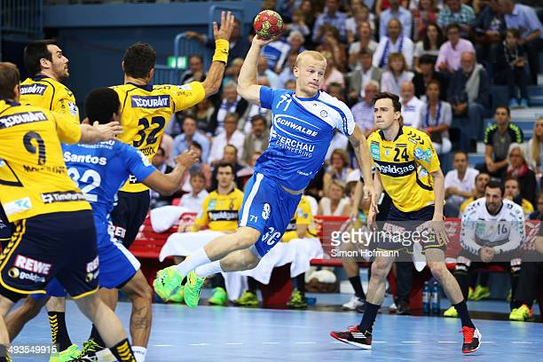 Andreas Schroeder of Gummersbach is challenged by Alexander Petersson and Patrick Groetzki of RheinNeckar Loewen during the DKB Handball Bundesliga...