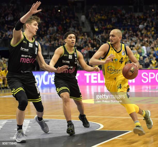 Andreas Seiferth James Robinson of medi Bayreuth and Stefan Peno of Alba Berlin during the easyCredit BBL game between Alba Berlin and medi Bayreuth...