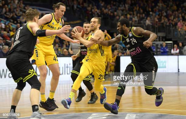 Andreas Seiferth of medi Bayreuth Dennis Clifford Spencer Butterfield of Alba Berlin and De'Mon Brooks of medi Bayreuth during the easyCredit BBL...