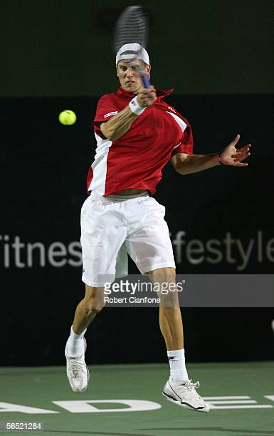 Andreas Seppi of Italy hits a forehand against James Blake of the USA on day three of the Next Generation Men's Hardcourts at Memorial Drive on...