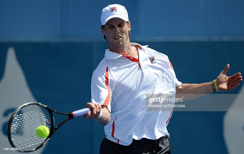 Andreas Seppi of Italy hits a return against John Millman of Australia during their match at the Sydney International tennis tournament on January 9, 2013.